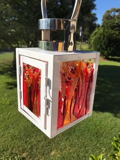 I took the panels out of this lantern and replaced with some fused glass panels I had done. Outside in sun. Quite happy with how it turned out.