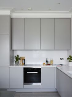 Love Interiors are interiors designers based in London, here you can view their portfolio. Modern Grey Kitchen, Light Grey Kitchens, Small Modern Kitchens, Grey Kitchen Designs, Kitchen Room Design, Modern Kitchen Design, Kitchen Layout, Home Decor Kitchen, Interior Design Kitchen