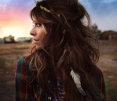 everything about this picture is beautiful..the girl and even the colorful sunset behind her <3