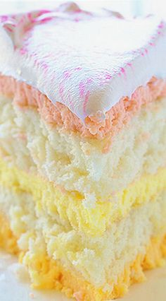Spring Cheesecake Cake  (layers of white cake with raspberry, lemon & orange cheesecake)