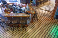 white oak paired with walnut really pop as The Starboard Restaurant's new floor. This famous bar and restaurant in Dewey Beach, Delaware goes throu.