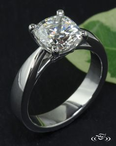 Classic Platinum Diamond Solitaire Engagement Ring  A cushion cut diamond is the star of this classic platinum four prong solitaire engagement ring. #Ido #GreenLakeMade #EngagementRing