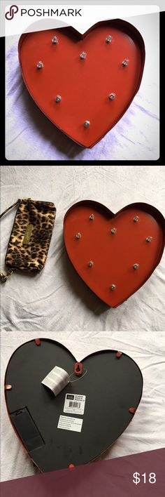 Marquee Heart Home Decor (tin) Lights 🎥 decorate! This adorable heart is perfect for your interior decorating project. All you need is two AA batteries and this lights up to give your mantel or wall a great glow! Placed next to a small clutch to show size. Accessories