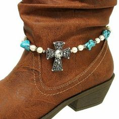 """Fashion Jewelry ~ Turquoise Silver Beads Boot Chain with Assorted Pearls Like Beads, Natural Rock Like Stones and a Crystal Accented Cross Charm (Style Boot Charm 031a 24) Variety Gift Shop Fashion Jewelry. $12.95. ** BOOT NOT INCLUDED **. 1 pc. Size: Total length: 16"""" L     Charm: 1.75"""" L x 1.25"""" W     Color: Turquoise, Silver     Style: Boot chain with assorted pearl like beads, natural rock like stones and a crystal accented cross charm."""