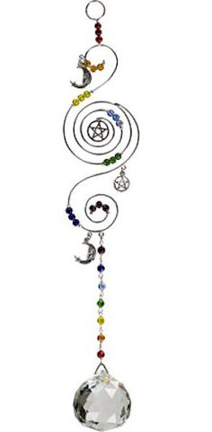 This beautiful, silver- toned, triple-spiral crystal hanger features a center pentacle. Woven throughout the spiral are groups of colored beads, representing the chakras. Silver crescent moons and pentacle charms dangle from the spiral and the attached loop makes hanging easy. Attached to the base is a strand of chakra beads and a stunning multi-faceted clear crystal sphere. This wonderful hanger will add interest and sparkle to any home, patio or garden.
