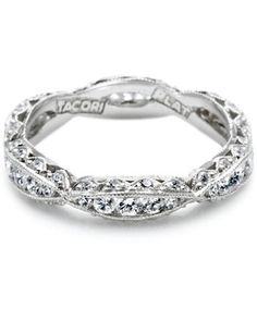This+platinum+and+diamond+band+has+a+romantic+ribbon-twist+with+diamond+accents.+Available+in+Platinum+and+18K+gold.+0.87ct+G,+VS.