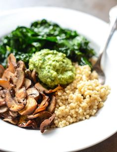 Super Vegan Couscous Bowl - Cremini mushrooms, Israeli couscous, kale, and parsley-cashew pesto. Note that I don't like to call the recipe by its original name, a Buddha Bowl, as that's cultural appropriation.