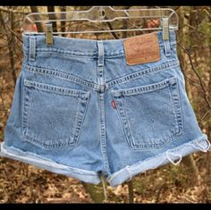 "Vintage levi's high waisted shorts Vintage cut off high rise shorts  Brand: Levi's Marked size: 10 100% cotton  Approximate measurements laying flat 14"" waist 12"" rise 3"" inseam 20.5"" hips (bottom of zipper edge to edge) Levi's Shorts Jean Shorts"