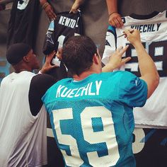 from Carolina Panthers Cam Newton and Luke Kuechly the last players signing autographs after practice today.