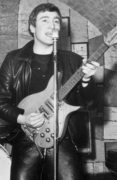 December 1961: Singer, guitarist and songwriter John Lennon (1940 - 1980) of the British group The Beatles live on stage at the Cavern Club in Mathew Street, Liverpool.