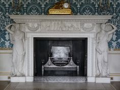 neoclassical fireplace in the Drawing Room at Kedleston Hall    Kedleston Hall is a stately home in Derbyshire, England, owned by the National Trust. It is the seat of the Curzon family and was built from 1759-65 for Nathaniel Curzon, the first Baron Scarsdale. The main architect was Robert Adam, the famous exponent of neoclassicism.    This picture shows the marble fireplace in the Drawing Room, with a pair of caryatids holding up the mantelpiece.