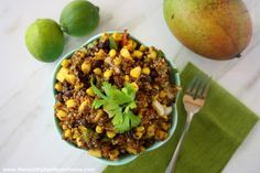 A healthy quinoa salad with sweet mango, spicy jalapenos, black beans, corn, cilantro, avocados, tomatoes, onions and a tangy lime dressing for a clean vegan meal.