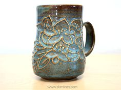 I've opened an etsy to list my handmade ceramic cups. https://www.etsy.com/listing/223142166/glossy-blue-and-bronze-ceramic-mug-with