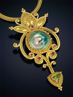 """Jack and Elizabeth Gualtieri frame an abalone blister pearl with 22kt gold granulation in the """"Empress I Pendant."""""""
