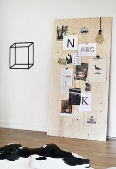 It only takes a few minutes to make this DIY plywood bulletin + memo board.