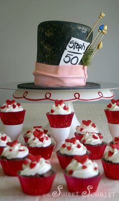 @Marie Davis Mad Hatter 50th Birthday Cake with Queen of Hearts Cupcakes #madhatter