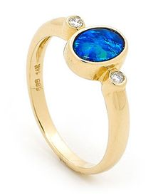 Royal Blue Opal Diamond Classic Style Ring.Our Master Goldsmiths selected Australian Light Doublet Opal sourced from the Coober Pedy opal producing region in south Australia and has set the precious gemstone in 14k Yellow Gold to create a stylish jewellery design. The two round brilliant cut diamonds makes this a real classic style.Classic and traditional design great for gifts for any family or loved ones. #opalsaustralia