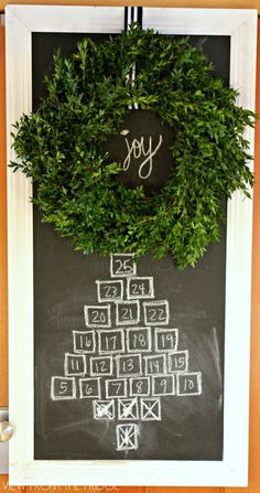 Idea! Create your own advent calendar with a chalkboard and fresh boxwood wreath! Beautiful!