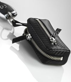 Black key case in carbon fibre-style leather. The Black Keys, Key Case, Carbon Fiber, Mercedes Benz, Wallets, Leather, Style, Swag, Purses