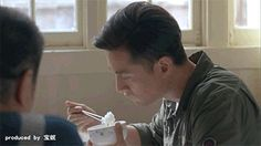 A Chinese guy shows you how to eat rice with a pair of chopsticks.