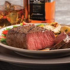 JIM BEAM BLACK BOURBON MARINATED TOP SIRLOINS: ~ From Omaha Steaks.Com: ~ The unmistakable full-bodied flavor of Jim Beam Black® meets the world-class tenderness of an Omaha Steaks Top Sirloin in this recipe for Bourbon Marinated Sirloins. Each succulent steak is infused with hints of honey, caramelized nut and warm oak notes that are accentuated by the distinctly rich tastes of barbecue sauce and Worcestershire sauce.