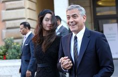 George Clooney and Amal Clooney leave at the end of 'Un Muro o Un Ponte' Seminary held by Pope Francis at the Paul VI Hall today