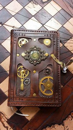 Steampunk Tendencies | Steampunk Journal 5x7 solid brass gears from an old clock. Copper mesh background ~ Shananigens In Leather https://www.facebook.com/groups/steampunktendencies/permalink/641889335865506