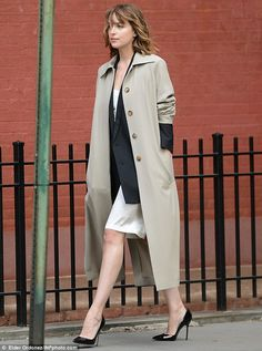 Stopping traffic: Dakota Johnson took part in a sexy photo shoot in New York City on Friday morning