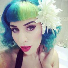 A great basic hair-do. curles, bangs and a large hair flower clip @gabbikatz #Bluehair @thebluehairedbetty #manicpanic