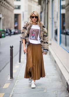 Model and fashion blogger Gitta Banko wearing pleated brown skirt in leather look from HM tshirt by Recyle Idols stripped fur jacket by Fur Ines...