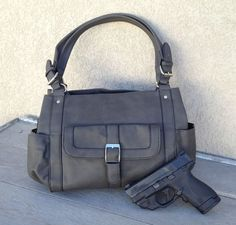 NEW! Now in Gunmetal gray for the perfect fall neutral. We've redesigned the Addison for fall and added the benefit of a slash proof strap. It has all the features of your favorite purse along with the added protection of a concealed carry compart...