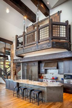 Sensationally rustic kitchens in mountain homes Rustic Kitchen and Railing - I like the pocket doors on the loft. Limits noise from traveling up.Rustic Kitchen and Railing - I like the pocket doors on the loft. Limits noise from traveling up. Style At Home, Metal Building Homes, Building A House, Building Ideas, Building Design, Morton Building Homes, The Loft, Sweet Home, Rustic Kitchen Design