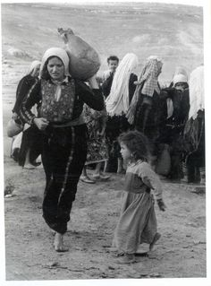 Palestinian woman having to leave what is now Israel, 1948 http://www.hanini.org/images/26.jpg
