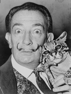 """Dali owned two ocelots, Babou and Bouba, one or both of whom accompanied him frequently. According to one tale, Dali was once visiting an art gallery in Paris with the ocelot Babou. The owner came up to Dali, yelling """"your goddamned cat has made a nuisance on my priceless 17th-century engravings,"""" Dali responded: """"A nuisance of Dali's,"""" said Dali, """"can only increase their value."""""""