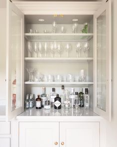 Hidden Bar in Living room/Dining Georgian Farmhouse Kitchen, Hampshire - Humphrey Munson Kitchens - Counter top glazed cupboard with glass shelves for displaying glassware and gin collection. Bar Interior, Interior Design, New Kitchen, Kitchen Decor, Kitchen White, Kitchen Sink, Alcove Cupboards, Rooms Ideas, Home Bar Designs