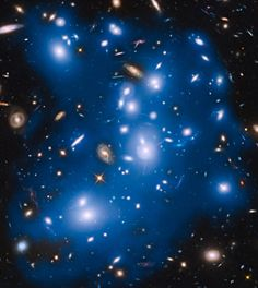 """NASA's Hubble Space Telescope has picked up the faint, ghostly glow of stars ejected from ancient galaxies that were gravitationally ripped apart several billion years ago. The mayhem happened 4 billion light-years away, inside an immense collection of nearly 500 galaxies nicknamed """"Pandora's Cluster,"""" also known as Abell 2744."""