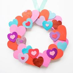 Whip up this colorful wreath in under 30 minutes using inexpensive foam hearts from the craft store!