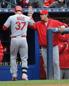 St. Louis Cardinals Team Photos - ESPN St. Louis Cardinals' Brandon Moss is congratulated as he comes to the dugout by manager Mike Matheny, right, after hitting a three run home run against the Atlanta Braves during the third inning of a baseball game, Sunday, April 10, 2016, in Atlanta. (AP Photo/John Amis)