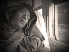 A Buddhist monk sleeping on the train to Katha (Julio Etchart)