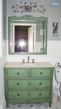 Distressed green dresser as a vanity