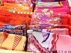 Hermes scarves, so many colors. Though made for women, a man like myself(confident) could pull them off with ease.