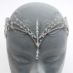 I don't even know if I can have a crown, but I WANT ONE. *Frolicks away, dropping shreds of paper*