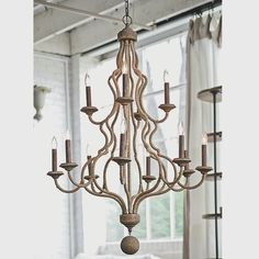 """Jute Wrapped Two Tier Chandelier  Two tiers of curled metal are wrapped in jute rope for a nautical look with sophistication or also a great look for rustic chic style. A distressed wooden sphere hangs at the bottom to finish the rustic chic appeal and is optional. The combination of size, shape, and texture make this chandelier truly special.   12 lights. (candle base socket)  (46""""Hx34""""W)  5"""" canopy  5' chain  Product SKU: CH11084 NA  Price:  $999.00"""