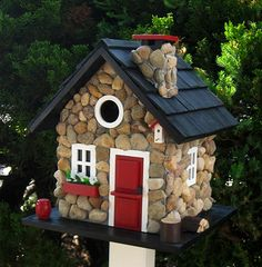 The Windy Ridge Birdhouse is a charming rustic cottage that will add whimsy to your garden and quality living quarters for your backyard birds. With painted black pine shingled roof, a removable back wall for easy cleaning, ventilation, drainage, unpainted interior, and a 1.25 inch entrance, the Windy Ridge House will be a welcoming nesting box for small songbirds.