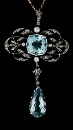A Belle Epoque 14k gold, aquamarine and rose cut diamond pendant, St Petersburg, early 20th century.