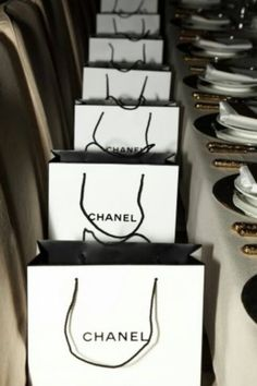 Great idea for the Bridal shower. Do a Chanel Theme. go lux. set things in cream black and gold! With Chanel gift bags on the chairs. Great look. Chanel Party, Paris Chic, Gabrielle Bonheur Chanel, Mademoiselle Coco Chanel, Casual Chique, Vogue, Goodie Bags, Gift Bags, Favor Bags