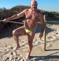 a bald bearded beach manly bear