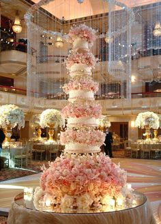 This romantic pink and white confection, overflowing with sugar flowers, is perfect for brides who are looking for a showstopper.