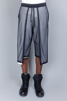 Gareth Pugh - Creating a new take on the basketball short shape and silhouette with layering. This reinvention illustrates innovation in design whilst function is inhibited for athletic based purposes. Credit: unknown