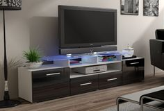 EVORA TV CABINET is a modern tv cabinet that will add a unique look to your living room. It has two doors and two drawer. Glass shelf  at the top - 8 mm thick. The whole body of the stand is manufactured using high quality mdf board in matt white finish (body of the tv cabinet) and fronts black high gloss finish.